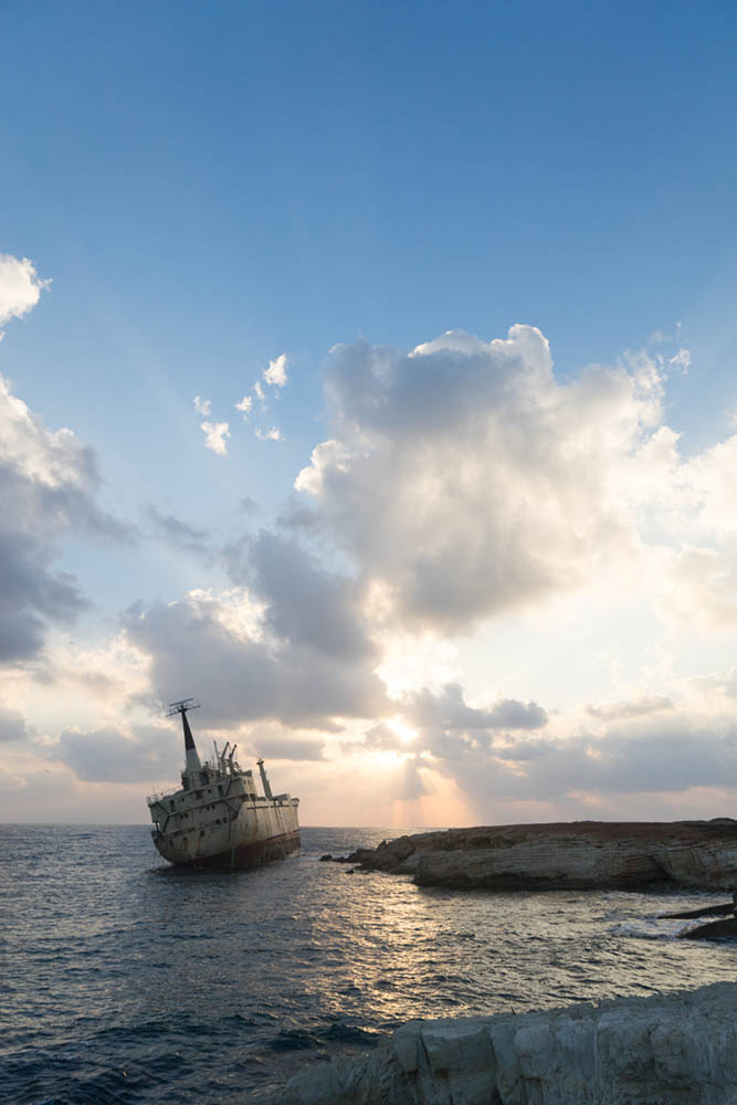 Without exposure compensation (the camera's 'correct' exposure), on this image of shipwreck in Cyprus, the sky looks too light