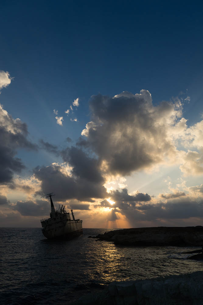 By using exposure compensation on the shipwreck in Cyprus we can make the sky more pleasing, but everything else is too dark, but we then use dodge and burn techniques to correct this. See image at end of post.
