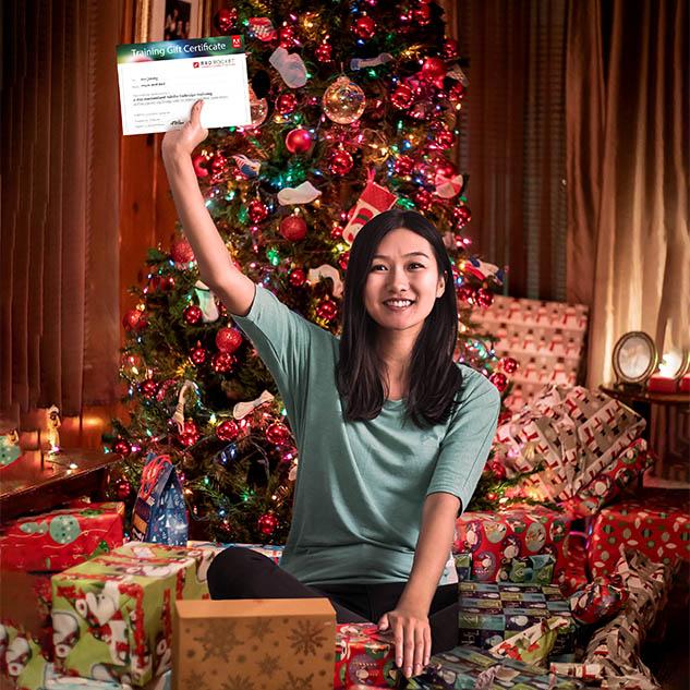 Trainee holding red rocket studio gift voucher